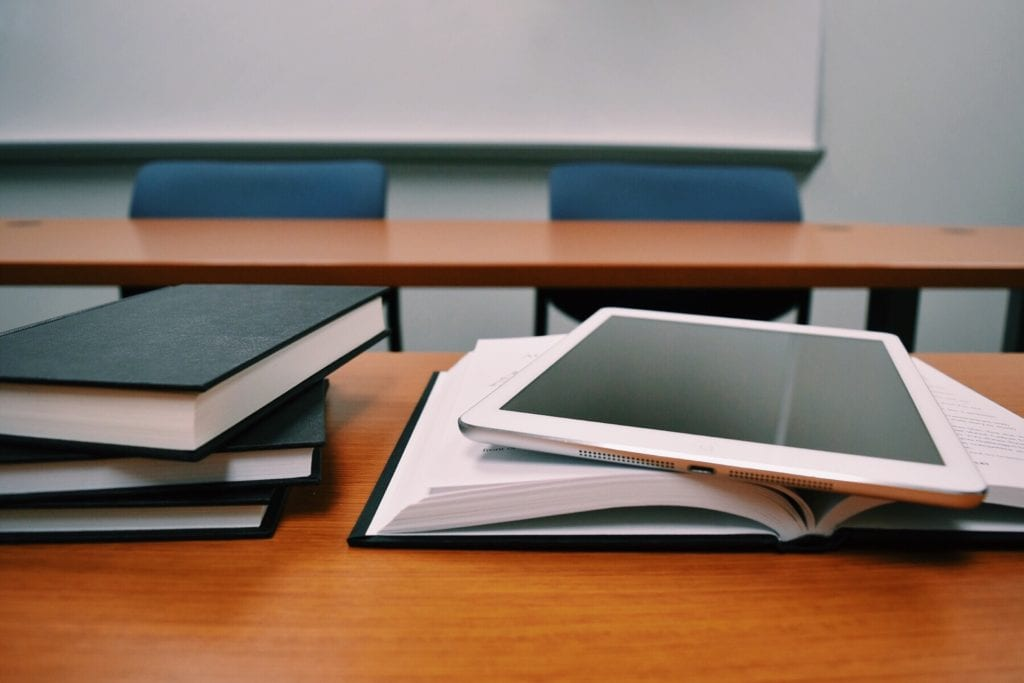 tablet on top of books