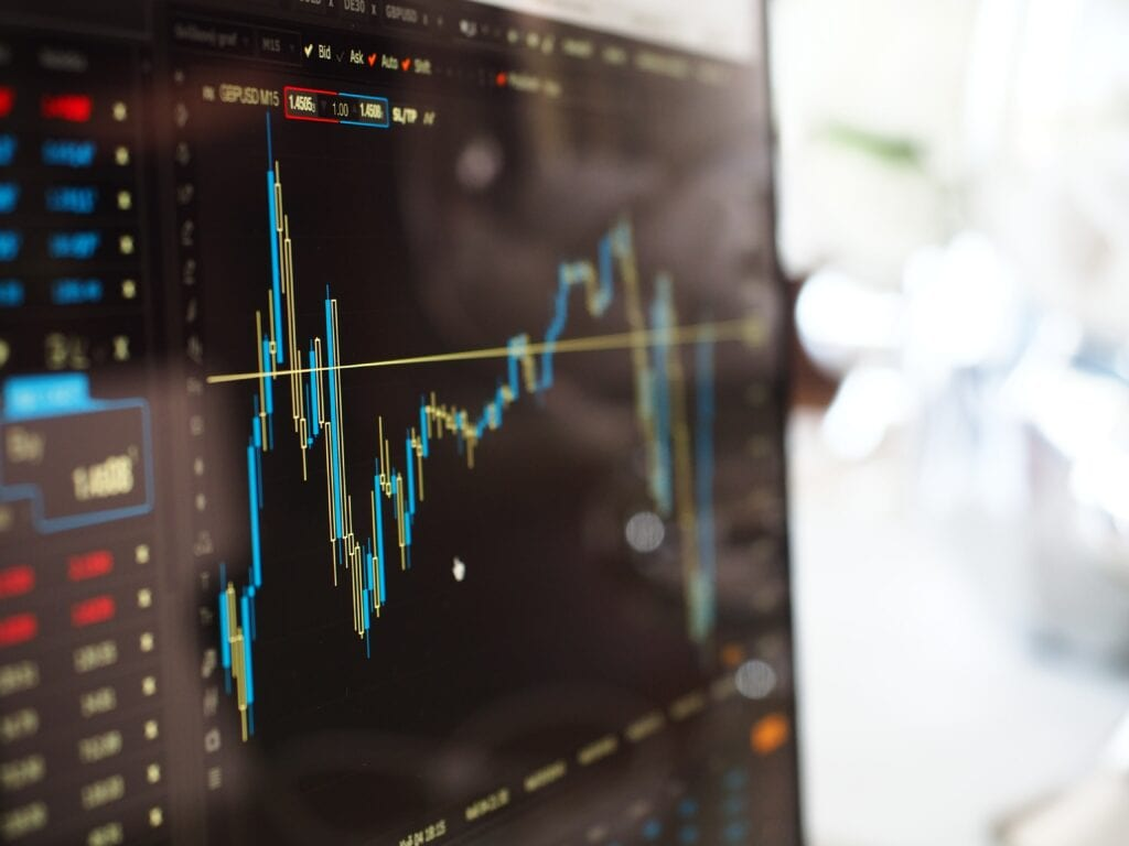 stocks fluctuating on computer screen